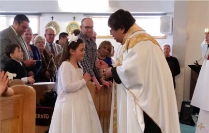 Young girl one First Communion April 3, 2016